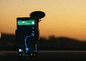 smartphone displaying gps map on holder inside car 2996306